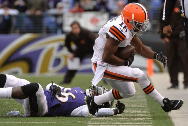 Cleveland Browns wide receiver Andrew Hawkins (16) brings in a three yard pass against Baltimore Ravens strong safety Matt Elam (26) at M&T Bank Stadium in Baltimore, Maryland on December 28, 2014. The Ravens defeated the Browns 20-10. UPI/Kevin Dietsch
