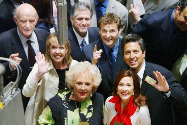 The cast of Everybody Loves Raymond, including Peter Boyle, Monica Horan, Doris Roberts, CBS Chairman Les Mooves, Phil Rosenthal, executive producer of the show, Patricia Heaton and Ray Romano, tour the floor of the New York Stock Exchange in 2005. Horan is to guest star on Heaton's sitcom The Middle on April 11. File Photo by Monika Graff/UPI