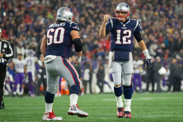 New England Patriots quarterback Tom Brady (12) and center David Andrews (60) celebrate after a touchdown by fullback James Develin (not pictured) in the fourth quarter against the Minnesota Vikings on Sunday at Gillette Stadium in Foxborough, Massachusetts. Photo by Matthew Healey/UPI