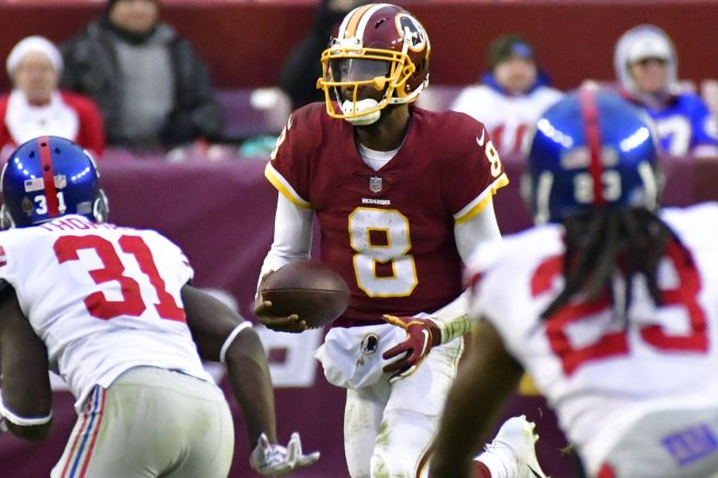 Washington Redskins quarterback Josh Johnson (8) runs a keeper play against the New York Giants during the second half of an NFL game at FedEx Field in Landover, Maryland, December 9, 2018. New York won 40-16. Photo by David Tulis/UPI