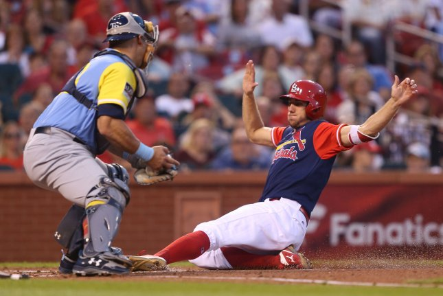 St. Louis Cardinals' Stephen Piscotty slides safely into home plate before the tag by former Tampa Bay Rays catcher Wilson Ramos. File photo by Bill Greenblatt/UPI