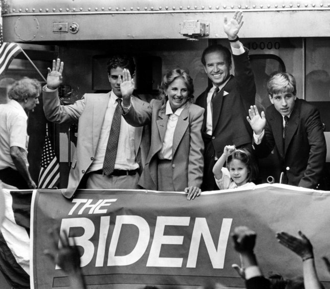 Then-Sen. Joe Biden, D-Del., waves with family members from the back of a special train in Wilmington, Del., after announcing his campaign for the 1988 Democratic presidential nomination on June 9, 1987. Biden commuted to Washington, D.C., from the train station for decades while he was in the Senate. UPI Photo/File