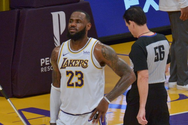 Los Angeles Lakers forward LeBron James (23), shown March 20, 2021, aggravated his right ankle injury during Sunday's loss to the Toronto Raptors. File Photo by Jim Ruymen/UPI