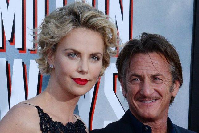 Cast member Charlize Theron and boyfriend Sean Penn attend the premiere of the motion picture western comedy A Million Ways to Die in the West at the Regency Village Theatre in the Westwood section of Los Angeles on May 15, 2014. A cowardly farmer begins to fall for a mysterious new woman in town but must test his new found courage when her husband, a notorious gun-slinger, announces his arrival. UPI/Jim Ruymen