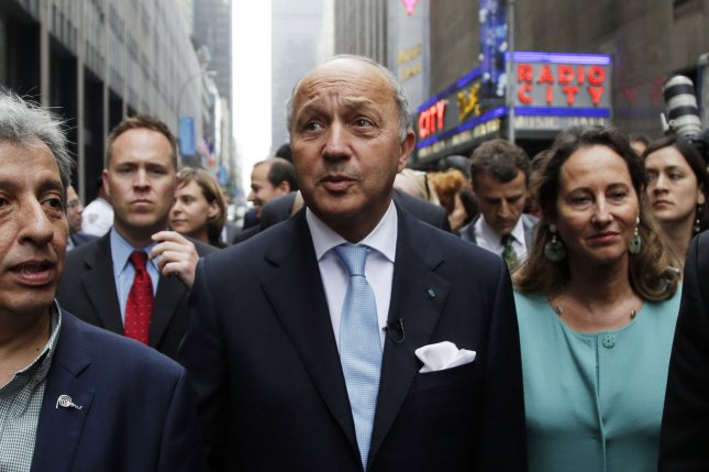 French Foreign Minister Laurent Fabius walks to 6th Avenue at the People's Climate March in New York City on September 21, 2014. Tens of thousands of demonstrators are expected to join the People's Climate March through midtown Manhattan preceding the 2014 U.N. Climate Summit. UPI/John Angelillo