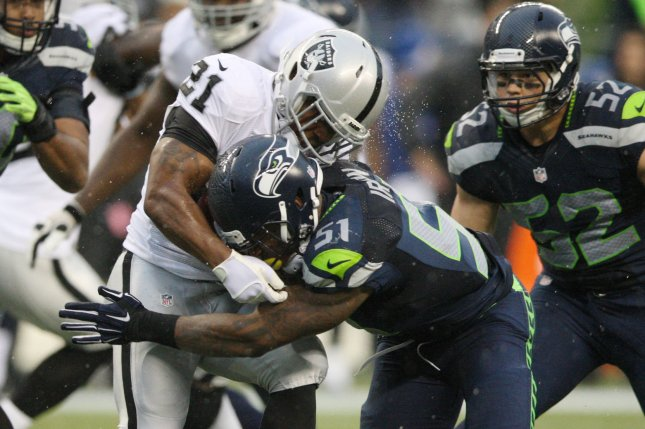 Seattle Seahawks linebacker Bruce Irvin (51) tackles Oakland Raiders running back Maurice Jones-Drew during the fourth quarter at CenturyLink Field in Seattle, Washington on November 2, 2014. The Seahawks beat the Raiders 30-24 in Seattle. UPI/Jim Bryant