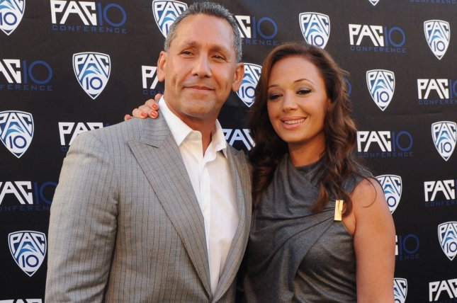 Actors and husband and wife Angelo Pagan and Leah Remini attend FOX Sports/PAC-10 Conference Hollywood premiere night in 2010. Remini is set to release a Scientology memoir due out in November. File Photo by Jim Ruymen/UPI