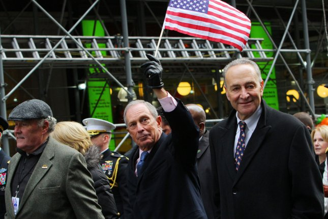 Former New York City Mayor Michael Bloomberg holds an American flag during a Veterans Day parade in 2013. Friday, Democratic National Committee chair Debbie Wasserman Shultz said it is unnecessary for Bloomberg to launch a third-party bid for the White House in 2016. Photo by Monika Graff/UPI