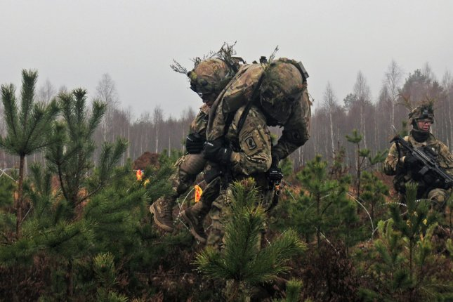 A U.S. paratrooper carries a wounded comrade off the battlefield during Exercise Iron Sword 2016, an international training exercise featuring 11 NATO countries and about 4,000 troops. The exercise was part of joint training between Lithuania, the United States and NATO member nations in Rukla, Lithuania. Photo by Staff Sgt. Corinna Baltos/U.S. Army/UPI