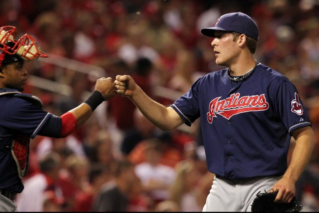 Cleveland Indians pitcher Nick Hagadone congratulates catcher Carlos Santana after the third out and a 6-2 win over the St. Louis Cardinals at Busch Stadium in St. Louis on June 8, 2012. UPI/Bill Greenblatt