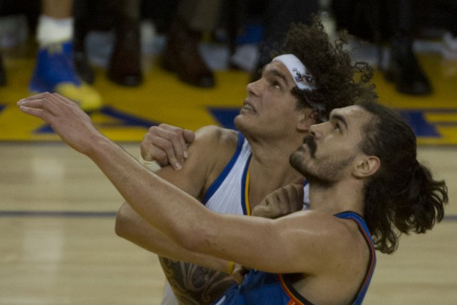 Golden State Warriors' Anderson Varejao (L) and Oklahoma City Thunder's Steven Adams look at the ball in the third period of game 2 of the NBA Western Conference Finals at Oracle Arena in Oakland, California on May 18, 2016. The Warriors rolled over the Thunder 118-91 to even the series at one game apiece. Photo by Terry Schmitt/UPI