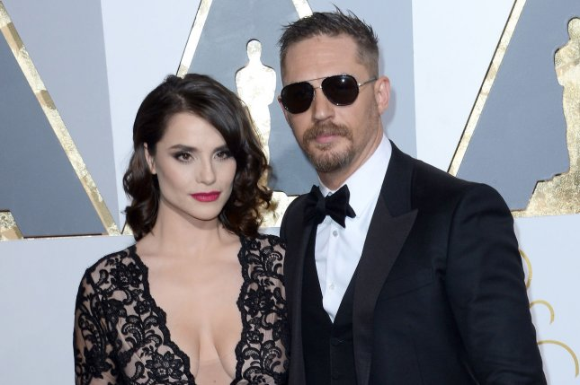 Actor Tom Hardy, right, and Charlotte Riley arrive on the red carpet for the 88th Academy Awards in Los Angeles on February 28, 2016. Hardy is to play Venom in a new Sony film. Photo by Jim Ruymen/UPI