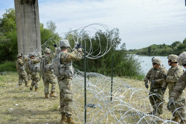Soldiers work alongside with U.S. Customs and Border Protection at port of entry in Hidalgo, Texas, applying wire along the Mexico border on November 2. President Donald Trump's emergency declaration Friday will divert military funding for project to fund construction of additional border barriers. File photo by Senior Airman Alexandra Minor/U.S. Air Force