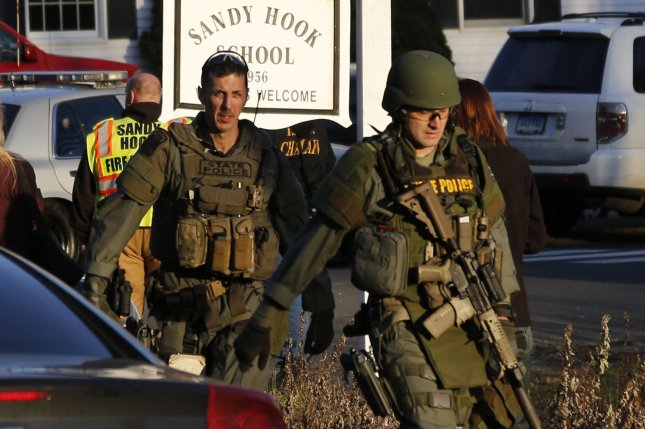 Police leave Sandy Hook Elementary School in Newtown, Conn., following a shooting attack that killed 26 people on December 14, 2012. File Photo by John Angelillo/UPI