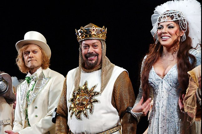 Left to right, David Hyde Pierce, Tim Curry and Sara Ramirez take their opening night bows in the Monty Python Broadway musical Spamalot in March 2005. Paramount has acquired a film version of the play. File Photo by Ezio Petersen/UPI