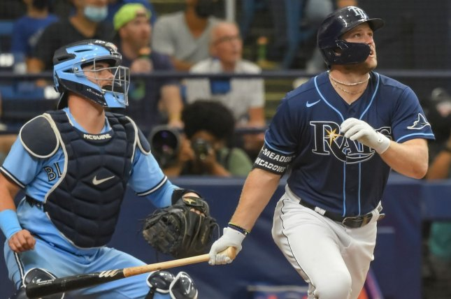 Toronto Blue Jays catcher Reese McGuire (L) watches Tampa Bay Rays designated hitter Austin Meadows hit a three-run home run Wednesday at Tropicana Field in St. Petersburg, Fla. Photo by Steven J. Nesius/UPI