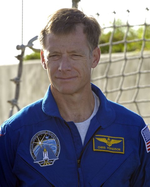 Astronaut Chris Ferguson, Pilot of STS 115, attends a press conference in front of launch pad 39B at the Kennedy Space Center, Florida on August 9, 2006. The entire crew is at the center to conduct a countdown rehearsal in preparation for their upcoming space shuttle mission. Atlantis' flight is scheduled for launch no earlier than August 27 to continue construction of the International Space Station. (UPI Photo/Joe Marino-Bill Cantrell)