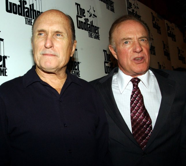 Actors Robert Duvall and James Caan (right) who starred in the first Godfather movie appear at a 2/10/05 promotional event in New York for EA Games which is producing The Godfather video game for release in mid 2005. The late Marlon Brando recorded his voice overs for the game shortly before he died in 2004. (UPI Photo/Ezio Petersen)