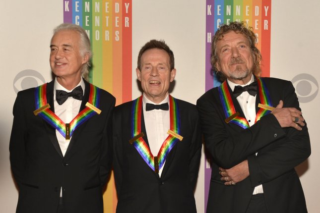 Members of the rock band Led Zeppelin (L-R) Robert Plant, John Paul Jones and Jimmy Page pose for photographers on the red carpet at the Kennedy Center in Washington, D.C., on December 1, 2012. The band will release a new compilation of BBC sessions in September after discovering a lost session from 1969, along with several other rare treasures. File photo by Mike Theiler/UPI