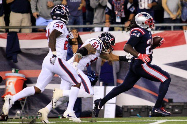 New England Patriots running back Legarrette Blount (29) escapes a tackle by Houston Texans linebacker John Simon (51) for a 41-yard touchdown in the fourth quarter at Gillette Stadium in Foxborough, Massachusetts on September 22, 2016. The Patriots defeated the Texans 27-0. Photo by Matthew Healey/ UPI