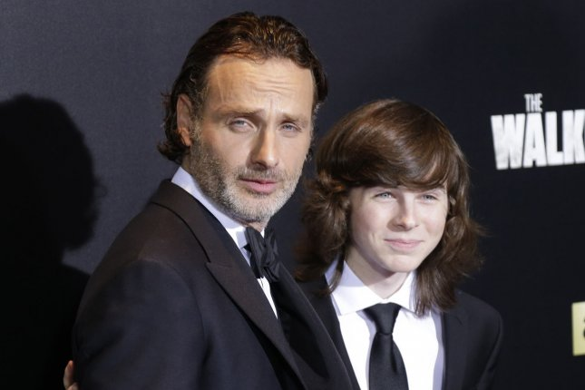 Andrew Lincoln (L) and Chandler Riggs arrive on the red carpet at the AMC's The Walking Dead Season 6 fan premiere event on October 9. Lincoln reprises his Love Actually role as Mark in the first teaser for the Love Actually reunion short. File Photo by John Angelillo/UPI