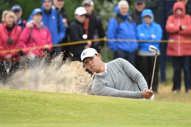 Korea's Si Woo Kim hits out of the bunker on the 9th green on Day two at the 146th Open Championship. Si Woo Kim became the latest winner of the Wyndham last year, beating Luke Donald of England by five strokes for his first PGA Tour victory at the age of 21. File photo by Hugo Philpott/UPI