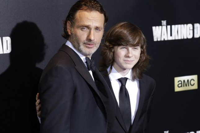 Andrew Lincoln and Chandler Riggs play father and son on The Walking Dead. The second half of the show's eighth season is to begin Sunday night on AMC. File Photo by John Angelillo/UPI
