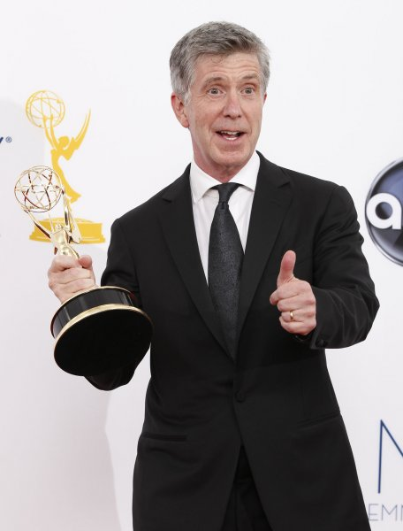 Dancing with the Stars host Tom Bergeron holds his Emmy backstage at the 64th Primetime Emmy Awards in Los Angeles on September 23, 2012. File Photo by Danny Moloshok/UPI
