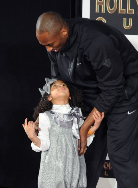 Los Angeles Lakers' Kobe Bryant hugs his daughter Gianna Bryant following a hand and footprint ceremony at Grauman's Chinese Theatre in Los Angeles on February 19, 2011. The two died January 26, 2020, in a helicopter crash. File Photo by Jim Ruymen/UPI