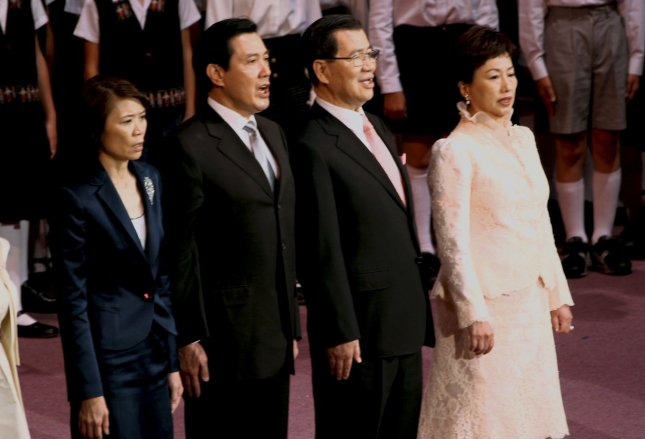 Taiwan's President Ma Ying-jeou (2-L), his wife Chow Mei-chin (L), Vice President Vincent Siew (2nd-R) and his wife Susan Chou (R) sing during the President Ma Ying-jeou's inauguration ceremony in Taipei on May 20, 2008. Ma was re-elected to a second term on January 14, 2012. (UPI Photo/SNP/Kouji Fukagawa)
