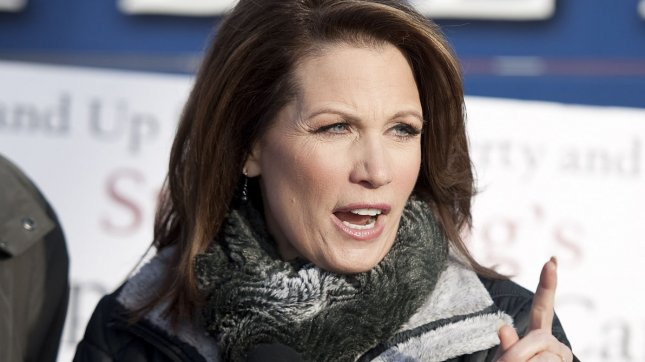 Republican presidential hopeful Rep. Michele Bachmann (R-MN) talks to reporters outside of her campaign bus on January 3, 2012 in West Des Moines, Iowa. UPI/Brian Kersey
