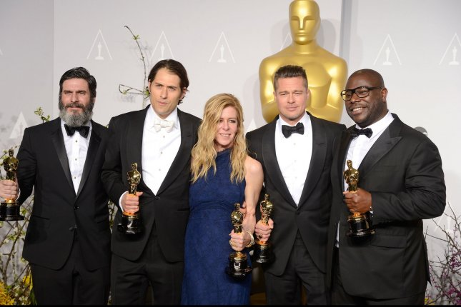 Left to right, Anthony Katagas, Jeremy Kleiner, Dede Garner, Brad Pitt and Steve McQueen pose with their Oscars after winning best picture for 12 Years A Slave backstage at the 86th Academy Awards at the Hollywood & Highland Center on March 2, 2014 in the Hollywood section of Los Angeles. UPI/Phil McCarten