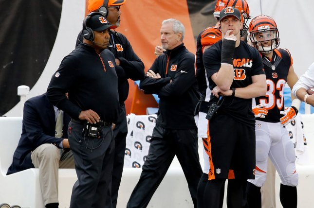 Cincinnati Bengals head coach Marvin Lewis (L) and quarterback Andy Dalton (R) watches their team from the side lines during the second half against the Pittsburgh Steelers at Paul Brown Stadium in Cincinnati, Ohio, December, 2015. Photo by John Sommers II/UPI