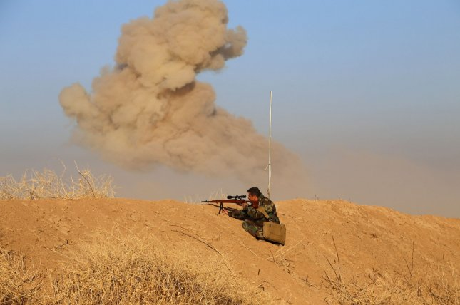 Iraqi security forces and Kurdish Peshmerga fighters are about 3 miles or less away from the center of the city of Mosul. In this image, an Iraqi Kurdish Peshmerga fighter watches from a sniping position as smoke billows in the distance as forces deploy in the area in Mount Zardak, near east Mosul, as they take part in an operation against the Islamic State October 17. File Photo by Shvan Harki/UPI