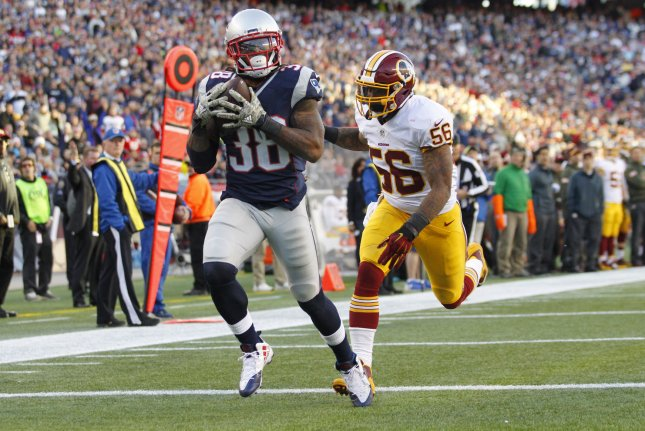 New England Patriots running back Brandon Bolden (38) pulls in an 18-yard touchdown reception while Washington Redskins linebacker Perry Riley, Jr. (56) gives chase in the fourth quarter at Gillette Stadium in Foxborough, Massachusetts on November 8, 2015. The Patriots defeated the Redskins 27-10. Photo by Matthew Healey/UPI