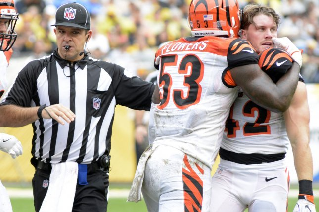 Former Cincinnati Bengals outside linebacker Marquis Flowers (53) restrains Cincinnati Bengals safety Clayton Fejedelem (42) who receives an penalty in the second quarter against the Pittsburgh Steelers at Heinz Field in Pittsburgh on September 18, 2016. File photo by Archie Carpenter/UPI