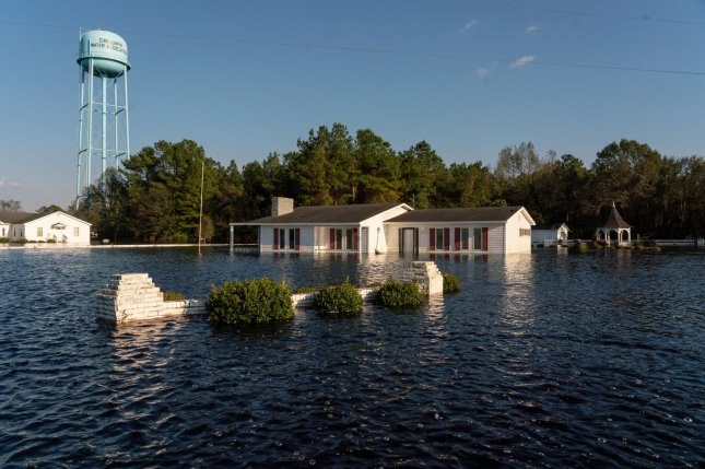A neighborhood in Chinquapin, N.C., is inundated with floodwaters on September 19, not long after Hurricane Florence moved out. File Photo by Ken Cedeno/UPI