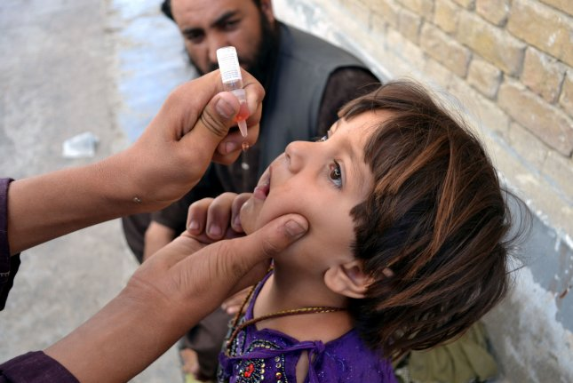 A health worker vaccinates a child in Chaman, Pakistan. Thursday's event aims to immunize 300 million children in middle- and low-income nations in the coming years. File Photo by Matiullah Achakzai/UPI