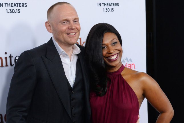 Bill Burr (L) and his wife Nia Renee Hill attend the premiere of Black or White on January 2015. Bur has announced a new comedy tour for 2021. File Photo by Jim Ruymen/UPI