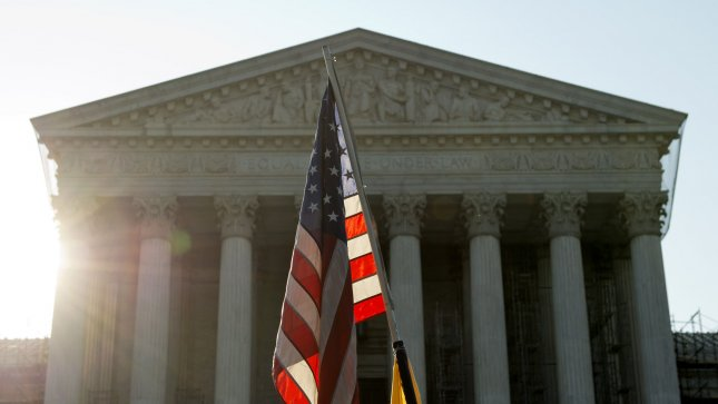 An American flag is seen in front of the United State Supreme Court on June 28, 2012 in Washington, D.C. The Supreme Court struck down Montana's restrictions on corporate political contributions last week. UPI/Kevin Dietsch