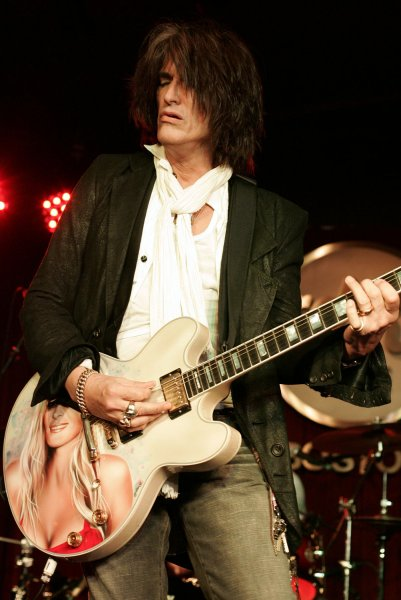 Joe Perry of the band Aerosmith, shown playing here with his sons' group Tab the Band in Boston in 2008, says Aerosmith bandmate Steven Tyler has left the longtime rock group. (UPI Photo/Matthew Healey)