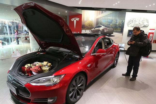 Chinese visit a new Tesla showroom in Beijing last November. Tesla announced plans to acuire SolarCity on Monday. File Photo by Stephen Shaver/UPI