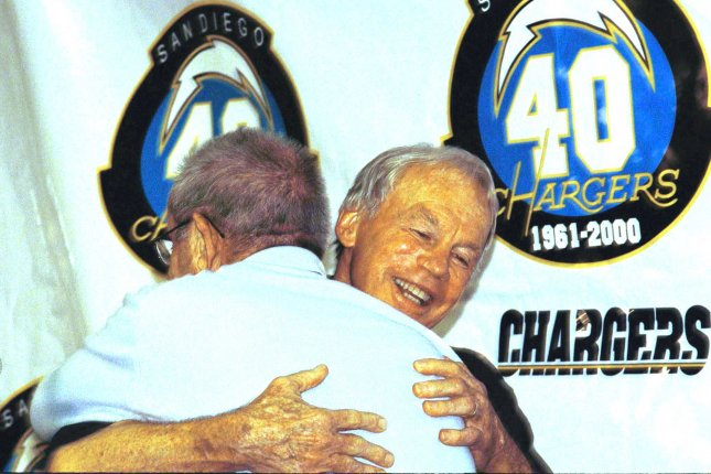 Retiring general manager Bobby Beathard gets a warm hug from his boss, Chargers owner Alex Spanos, on April 25, 2000 in San Diego, California. Beathard spent 37 years in the NFL. File photo by Robb Hughes/UPI