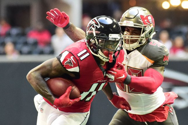 Atlanta Falcons receiver Julio Jones tries to elude the grasp of Tampa Bay Buccaneers linebacker Kwon Alexander during their game at Mercedes-Benz Stadium on October 14, 2018. Photo by David Tulis/UPI