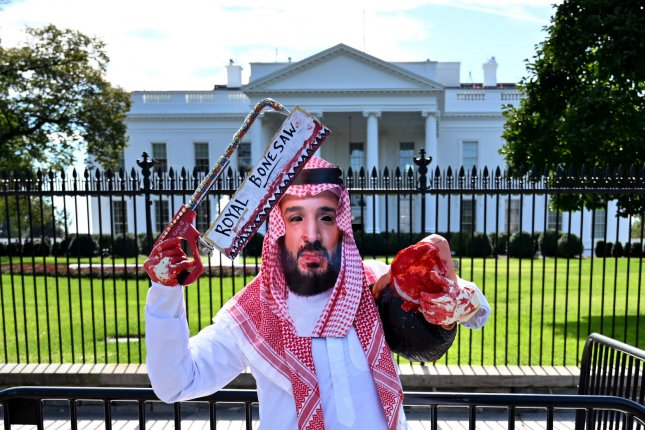 A protester dressed as Saudi Arabian Crown Prince Mohammed bin Salman demonstrates outside the White House with members of the activist group Code Pink to call attention to the disappearance of Saudi Arabian journalist Jamal Khashoggi. File Photo by Kevin Dietsch/UPI
