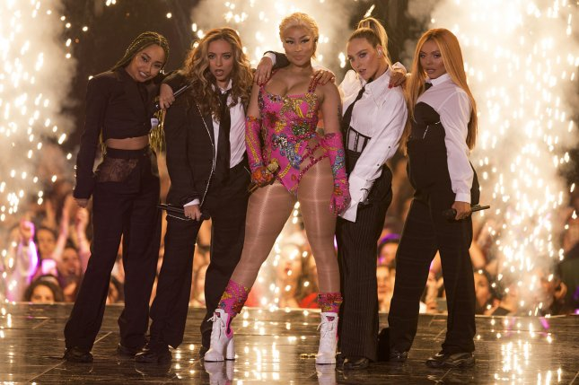 Nicki Minaj (C), pictured with Little Mix, spoke out on Instagram after pulling out of her tour stop in Bordeaux, France. File Photo by Sven Hoogerhuis/UPI