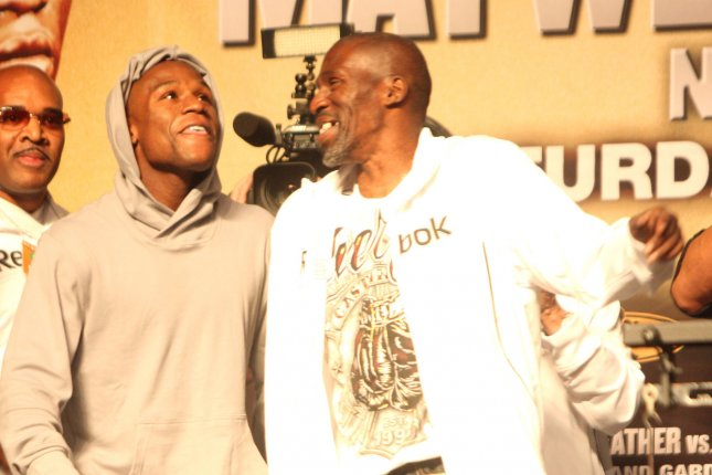 Roger Mayweather (R), a two-division boxing world champion, died Tuesday after a long battle with diabetes and other known health issues. File Photo by Roger Williams/UPI