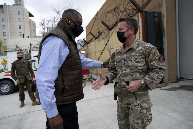 Secretary of Defense Lloyd Austin III (L) greets the commander of NATO's Resolute Support Mission and U.S. Forces – Afghanistan, Army Gen. Scott Miller, upon arrival at Resolute Support Headquarters in Kabul, Afghanistan, on March 21, 2021. Photo by Lisa Ferdinando/Department of Defense
