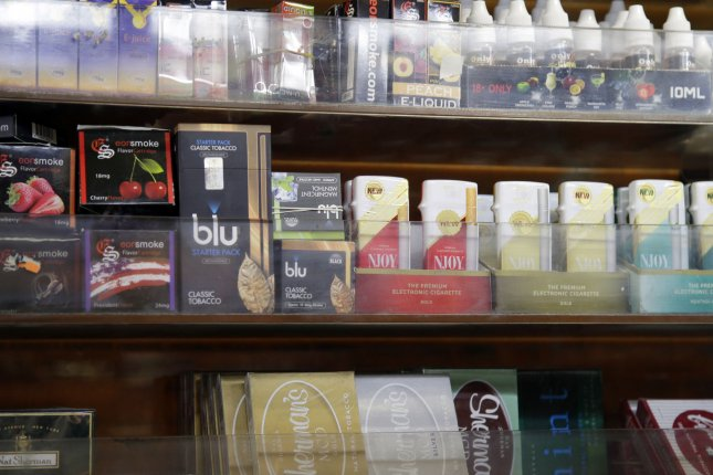 Electronic e-cigarettes and other tobacco products are on display inside a store in New York City. UPI/John Angelillo