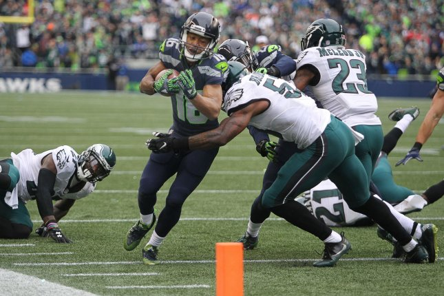 Seattle Seahawks Wide receiver Tyler Lockett (16) is taken out of bounds by Philadelphia Eagles linebacker Nigel Bradham (53) after catching a 30-yard pass from Russell Wilson at CenturyLink Field in Seattle, Washington on November 20, 2016. Seahawks beat the Eagles 26-15. Photo by Jim Bryant/UPI